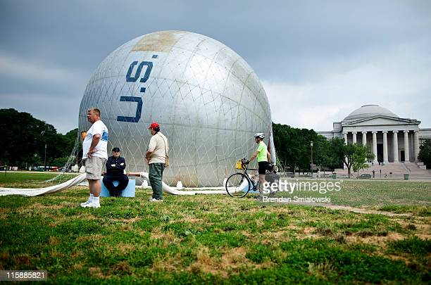 People look at an American Civil Warera observation balloon during a demonstration on the National Mall June 11 2011 in Washington DC Reenactors...