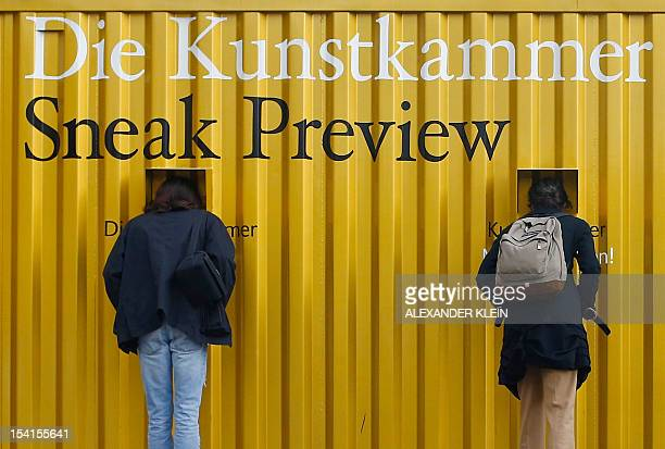 People look at an art exhibition preview of the Kunstkammer Wien displayed in a freight container in front of the Kunsthistorisches Museum in Vienna...