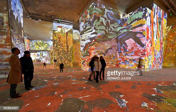 People look at an audio visual show projected on the walls of the 'Carrieres de Lumieres' site 'Monet RenoirChagallVoyages en Méditerranée' on...