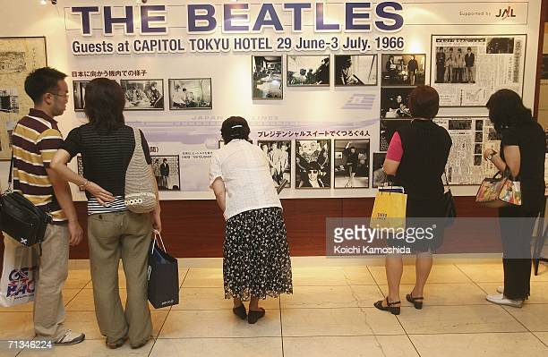 People look at an exhibition during the events to mark the 40th anniversary of the Beatles' 1966 visit to Tokyo at the Capitol Tokyu Hotel on July 1...