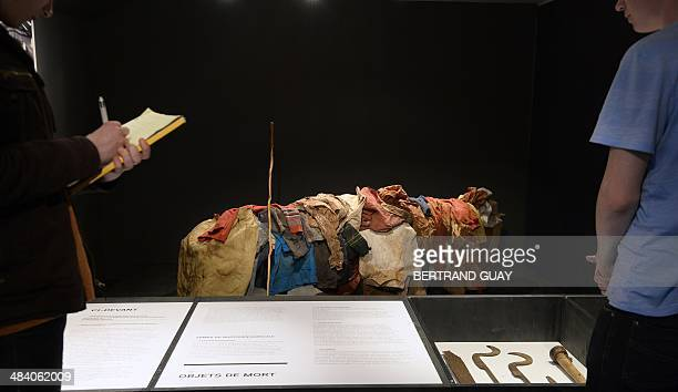People look at an exhibition on the Rwandan genocide at The Shoah Memorial in Paris on April 11 2014 April 7 2014 marked the 20th anniversary of the...