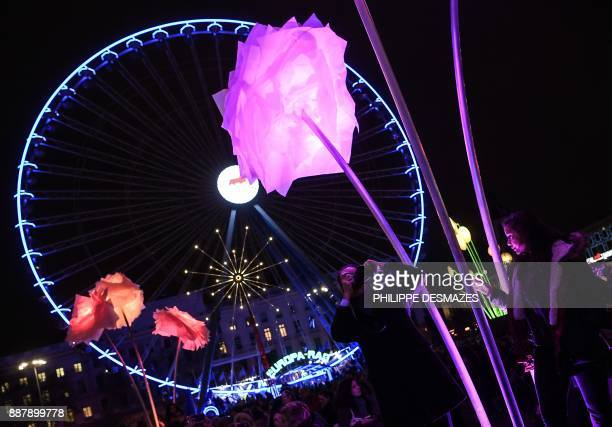 People look at an illuminated art installation on December 7 2017 in Lyon during the 19th edition of the Festival of Lights The Festival of Lights...