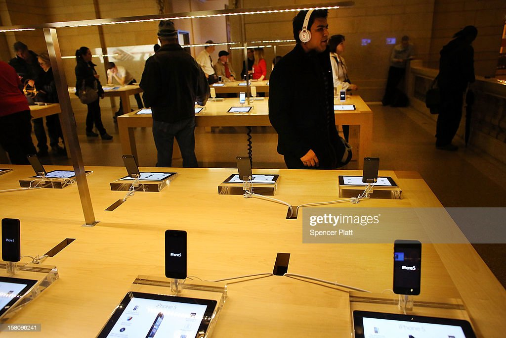 People look at Apple products at the Apple retail store in Grand Central Terminal on December 10, 2012 in New York City. Apple Inc. stock was down $4.56 per share, or 0.86 percent decline as investors and analysts worry that the U.S market is becoming saturated with apple products. Apple, the world's most valuable publicly traded company, has lost $167 billion in market value in less than three months.