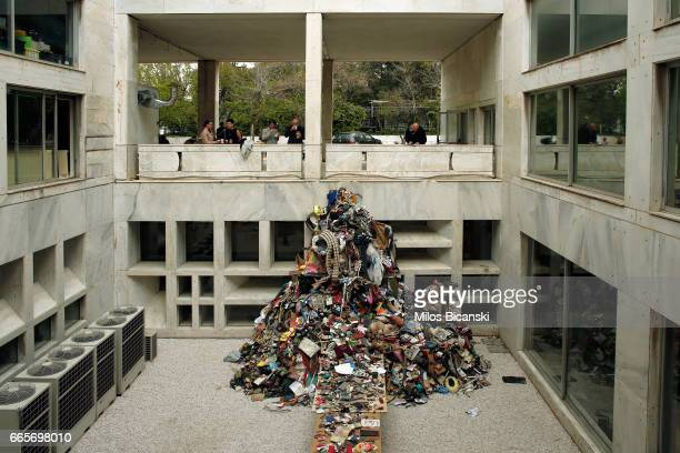People look at art work 'Artist book' from Daniel Knorr at a preview of Documenta 14 on April 7 2017 in Athens Greece Documenta is an exhibition of...
