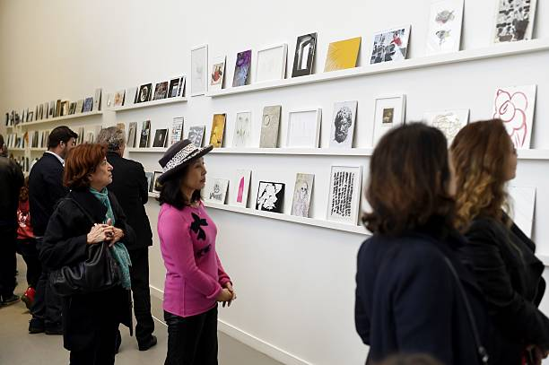 People look at artworks as part of the \'Recto/Verso\' exhibition ...