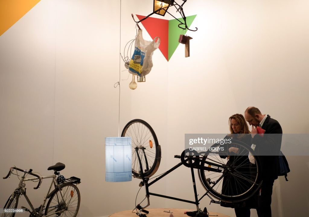 People look at 'Bismarck' an installation by German artist Manfred Pernice during the ARCO International Contemporary Art Fair opening in Madrid on February 21, 2018. Madrid hosts the annual Arco contemporary art fair, one of Europe's biggest, from February 21 to February 25, 2018. /
