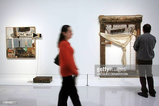 "People look at ""Black Market"" and ""Trophy III pieces by Texan artist Robert Rauschenberg, 11 October 2006 at the Centre Pompidou in Paris. The..."