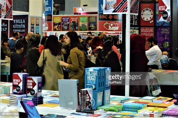 People look at books during the 12th International Ankara Book Fair in Ankara Turkey on February 17 2018