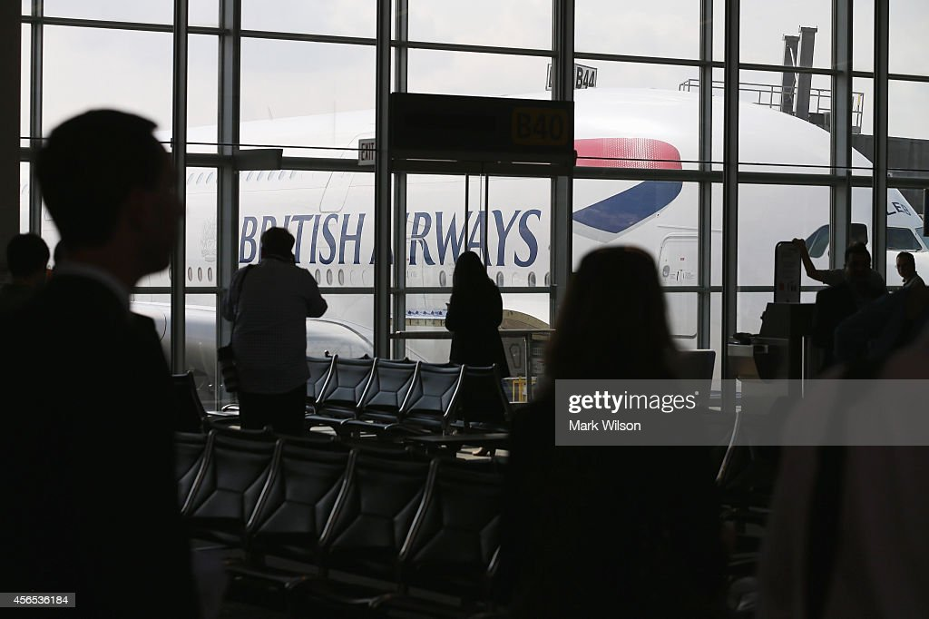 People look at British Airways' new super jumbo Airbus A380 after it arrived at Washington Dulles International Airport October 2, 2014 in Dulles, Virginia. British Airways introduced the first Airbus A380 nonstop service between London Heathrow and Washington Dulles International Airport.
