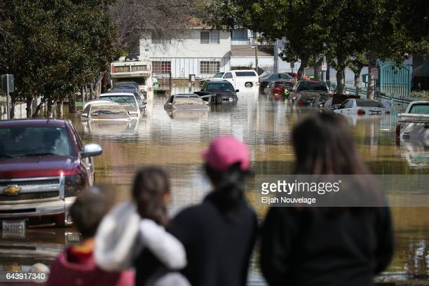 People look at cars and homes engulfed in floodwaters on February 22 2017 in San Jose California Flooding on Tuesday prompted the evacuation of over...