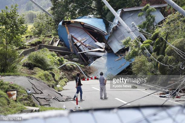 People look at collapsed buildings in Atsuma Hokkaido on Sept 6 after a landslide triggered by a strong earthquake ==Kyodo