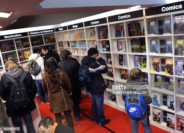 People look at comic books on the last day of the Comic book festival of Angouleme on February 3 2013 in Agouleme western France The awards ceremony...