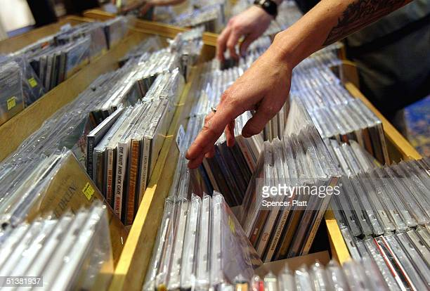People look at compact disks in a music store October 1 2004 in New York City A recent study by the International Federation Of The Phonographic...