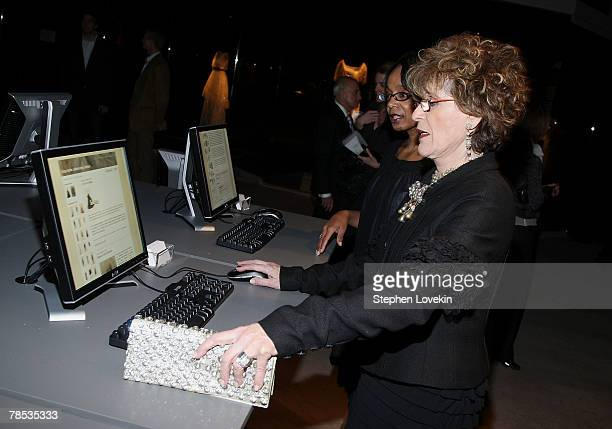 People look at computers at the Blogmode Addressing Fashion reception at The Metropolitan Museum of Art on December 17 2007 in New York City