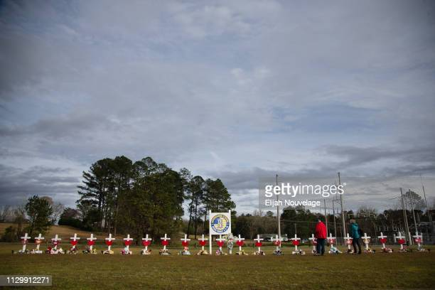 People look at crosses decorated with messages for the 23 victims of an EF4 tornado on the grounds of Providence Baptist Church on March 11 2019 in...