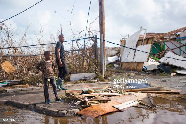 TOPSHOT People look at damage on September 7 in Marigot near the Bay of Nettle on the island of SaintMartin in the northeast Caribbean after the...