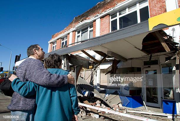 People look at damaged buildings after a 71 magnitude earthquake struck 30km west of the city at 435 am this morning September 4 2010 in Christchurch...