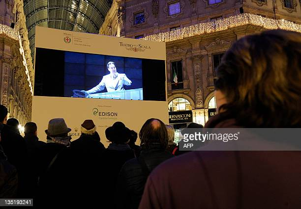 People look at Don Giovanni the opera opening the 20112012 season of La Scala opera house broadcasted live in the Vittorio Emanuele II gallery...