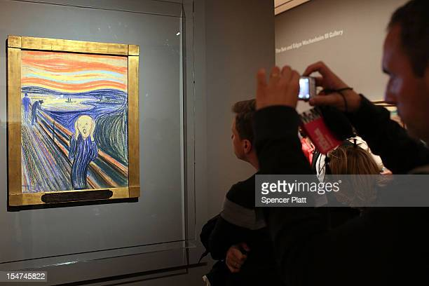 People look at Edvard Munch's 'The Scream' which went on display in Manhattan's Museum of Modern Art for a sixmonth exhibition October 25 2012 in New...