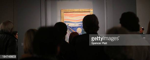 People look at Edvard Munch's The Scream which went on display in Manhattan's Museum of Modern Art for a sixmonth exhibition October 25 2012 in New...