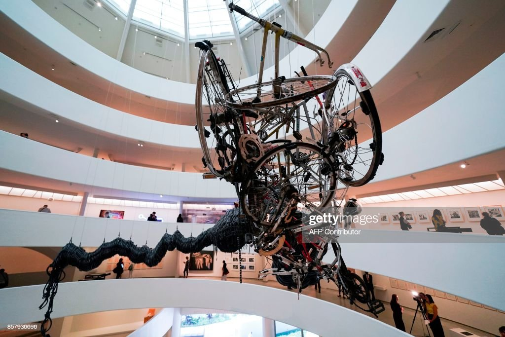 People look at exhibits during the 'Art and China after 1989: Theater of the World' media preview at the Solomon R. Guggenheim Museum in New York on October 5, 2017. / AFP PHOTO / Jewel SAMAD / RESTRICTED