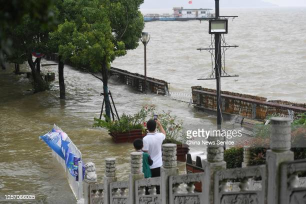 People look at flood waters on the bank of Chaohu Lake on July 19, 2020 in Hefei, Anhui Province of China.