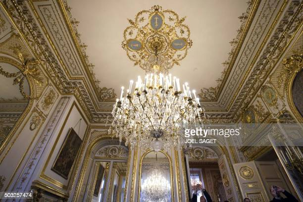 People look at furniture decoration and a chandelier on January 3 2016 during their visit of the Hotel de la Marine in Paris which is exceptionally...
