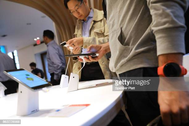 People look at Google's new Pixel 2 phones at a New York City popup shop on October 19 2017 in New York City The temporary store in the Flatiron...