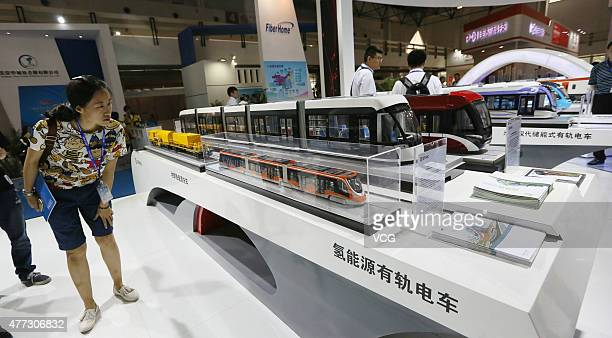 People look at hydrogen energy trams on booth of CRRC during UrTran 2015 on June 16 2015 in Beijing China International Urban Rail Exhibition held in...
