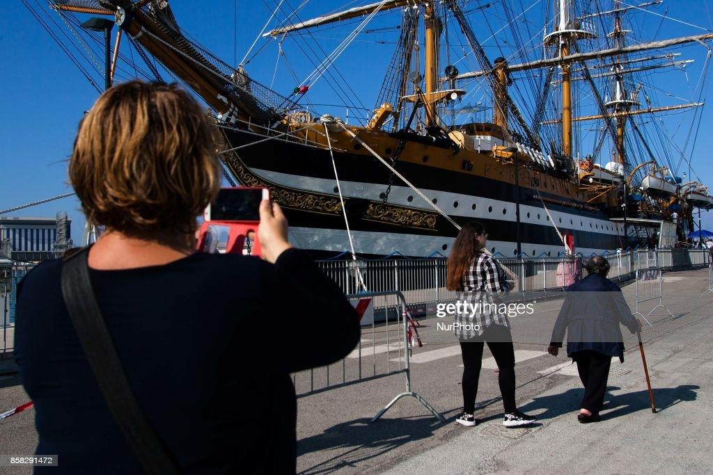 """People look at Italian sailing ship """"Amerigo Vespucci"""" in Naples, Italy, October on 06,2017"""