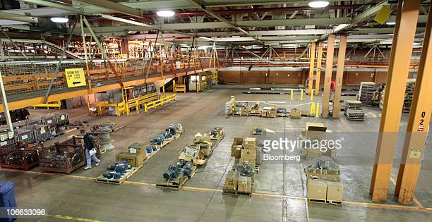 People look at items up for auction at the permanently shutdown General Motors Co Pontiac Assembly plant in Pontiac Michigan US on Thursday Nov 4...