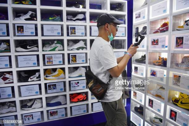 People look at Kobe Bryant basketball shoes as part of the Sneaker Con Museum at a shopping mall on May 29 2020 in Chengdu Sichuan Province of China