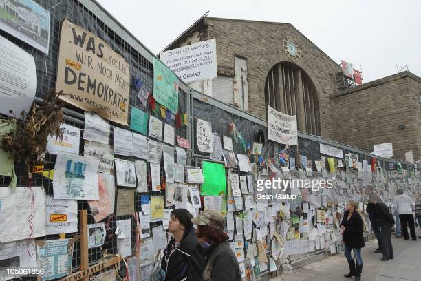 People look at messages left by activists who are against the Stuttgart 21 train station project outside Hauptbahnhof train station on October 8 2010...