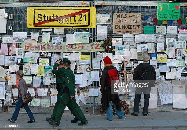 People look at messages left by protesters outside Hauptbahnhof train station as two police officers walk by on October 6 2010 in Stuttgart Germany...