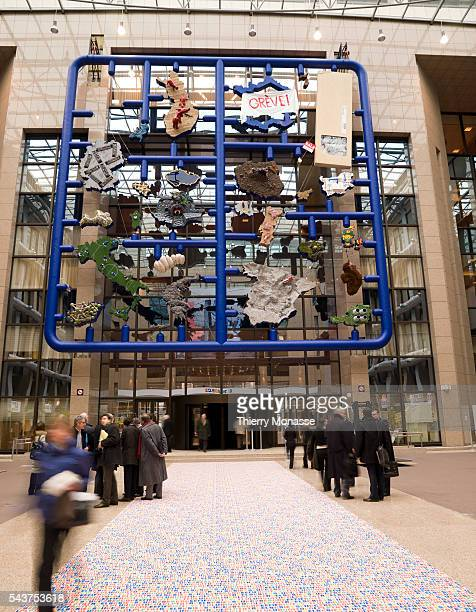 People look at modern art installation called 'Entropa' in the atrium of the European Council headquarters in Brussels The work was commissioned by...