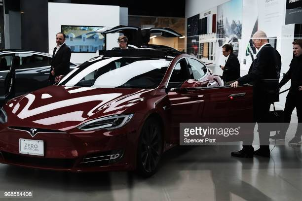 People look at new Tesla cars at a showroom in the Meatpacking district in Manhattan on June 6 2018 in New York City Tesla stock had its best day...