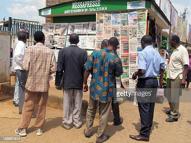 People look at newspapers featuring portraits of Cameroon's President at a newsstand in Yaounde on November 6, 2012. Cameroonian President Paul Biya...