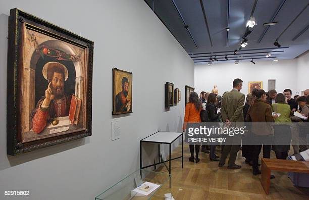People look at paintings by Italian Renaissance artist Andrea Mantegna on September 19 2008 at the Louvre museum in Paris before the inauguration of...