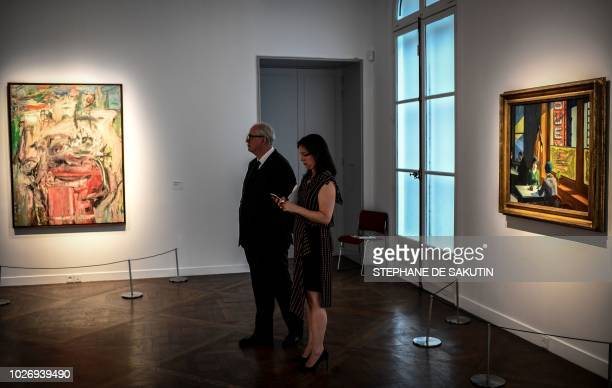 People look at paintings by US artist Willem de Kooning called Woman as Landscape and by US artist Edward Hopper called Chop Suey that are part of...