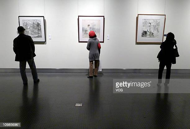 People look at paintings of Chinese contemporary feminine artists at Zhejiang Art Museum on the International Women's Day on March 8 2011 in Hangzhou...