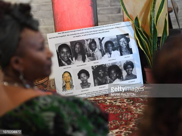 People look at photos of known victims of serial killers Lonnie Franklin known as the Grim Sleeper Samuel Little and other Los Angeles serial killers...