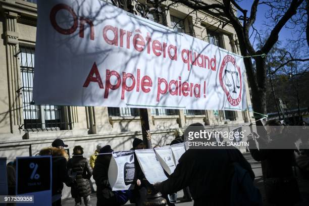 People look at placards displayed by activists of the Association for the Taxation of Financial Transactions and Citizen's Action under a banner...