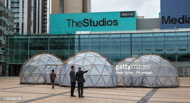 People look at Pollution Pods installed by Cleanairgmcom at MediaCityUK in Manchester People can experience the air quality of cities across the...