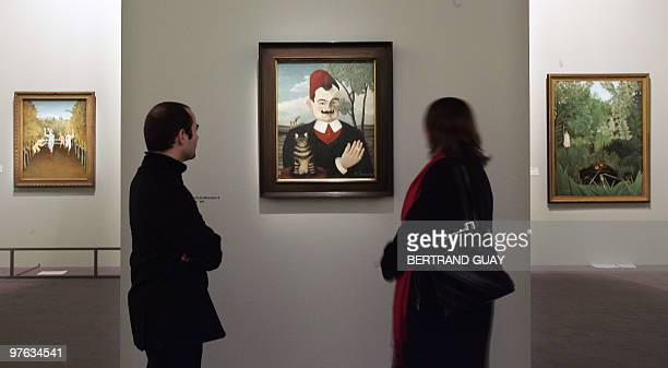 People look at Portrait de Monsieur X of French artist Le DouanierRousseau 09 March 2006 at the Grand Palais museum in Paris before the opening of...