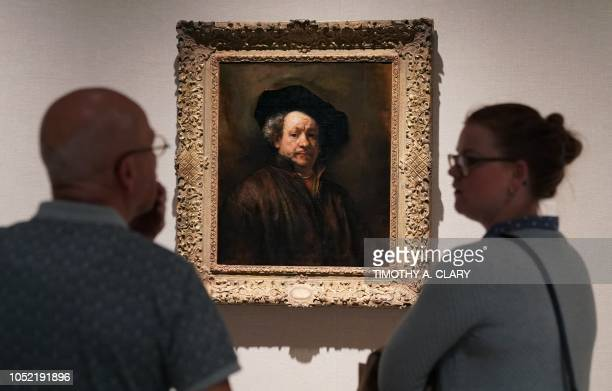 People look at Rembrandt's 'Self Portrait ' during a press previews at The Metropolitan Museum of Art October 15 2018 in New York for 'In Praise of...