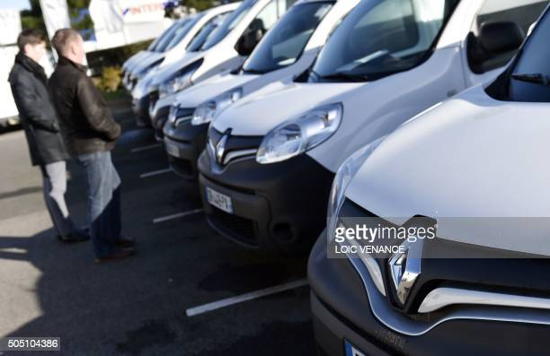 People look at Renault cars parked on the Renault distributor's parking in SaintHerblain western France on January 15 2016 A governmentappointed...