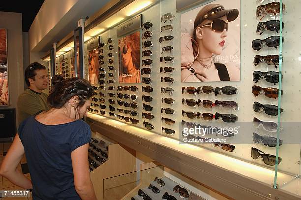 5a4ddc1820b66 People look at sunglasses at Sunglass Hut on Lincoln Road during the Sunglass  Hut Swim Shows