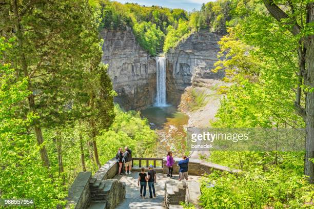 people look at taughannock falls finger lakes region upstate new york - finger lakes stock pictures, royalty-free photos & images