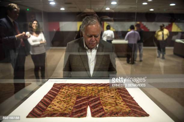 People look at textiles belonging to the preInca Paracas culture dating to 700 BCE100 BCE on display in Peru's Culture Ministry in Lima on December...