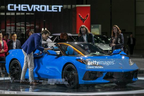 People look at the 2020 Chevrolet Corvette at AutoMobility LA on November 20 2019 in Los Angeles California The fourday press and trade event...